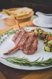 Rib steak on a white plate with ratatouille. Steak(entrecote, rib-eye, Rib steak, Scotch fillet Royalty Free Stock Photography
