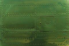Ribattini e fondo del metallo Fotografia Stock Libera da Diritti