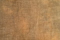 Ribbed corduroy texture background. Brown stock photography