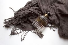 Ribbed glass perfume bottle and hazel scarf stock photos