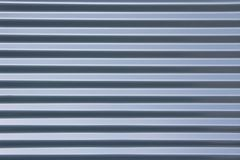 Ribbed metal blue background Stock Photography