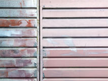 Ribbed metal  surface painted with  several colours Stock Photo