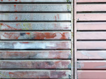 Ribbed metal  surface painted with  several colours Royalty Free Stock Photography