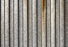 Ribbed metal texture. Silver and ribbed Royalty Free Stock Photos