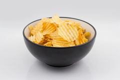 Ribbed potato chips in a bowl Royalty Free Stock Images