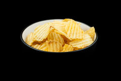 Ribbed potato chips in a bowl Stock Image