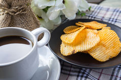Ribbed potatoes snack and coffee Stock Photography