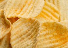 Ribbed potatoes snack with pepper on black background. Close up stock photo
