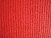 Ribbed red paper background Stock Images