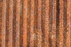 Ribbed rusty metal background Stock Images