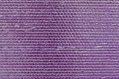 Ribbed texture of purple reflective shiny wall. Shining pink convex foil background. Abstract glitter pattern. Reflective violet s. Urface. Brilliant uneven royalty free stock photography