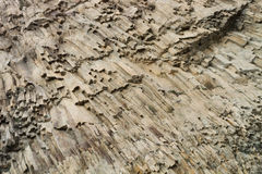 Ribbed texture of volcanic rocks on the cliff of Cape Fiolent Royalty Free Stock Photography