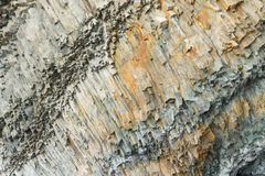 Ribbed texture of volcanic rocks on the cliff of Cape Fiolent Royalty Free Stock Images