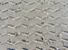Ribbed wheel tracks on dry sand. Perfect sand Stock Image