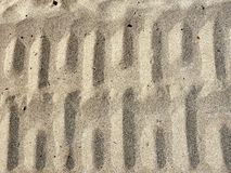 Ribbed wheel tracks on dry sand Royalty Free Stock Image