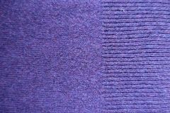Ribbing on the edge of knit stitch violet fabric. Ribbing on the edge of plain knit stitch violet fabric Royalty Free Stock Image