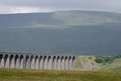 Ribblehead viaduct. Railway viaduct with hill in background in the Yorkshire Dales National Park, England Royalty Free Stock Photo