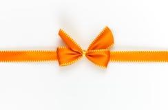 Ribbon. Orange gift ribbon isolated on white Royalty Free Stock Images