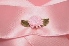 Ribbon. On christening cake close up stock photo