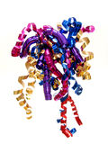 Ribbon. Close up of colorful, twirled New Year's Eve or party ribbon Stock Photos