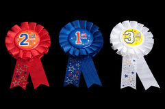 Ribbon awards for the first, the second and the third place. Three ribbon awards in red, blue and white for the first, the second and the third place with Stock Photo