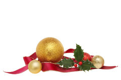 Ribbon ball and holly decoration Royalty Free Stock Images