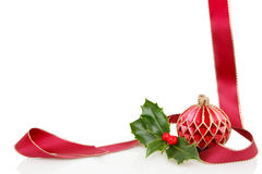 Ribbon ball and holly frame Royalty Free Stock Photography