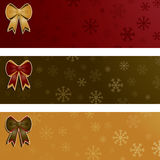 Ribbon banners. Red, green and gold seasonal snowflake banners with bows Royalty Free Stock Images