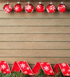Ribbon and baubles on wooden background Stock Photography