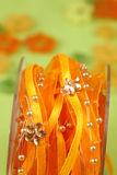 Ribbon with beads and flowers Royalty Free Stock Images