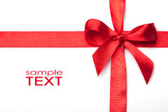 Ribbon with a bow as a gift on a white background Stock Image