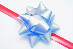 Ribbon and bow on gift Stock Images