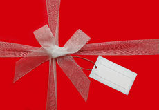 Ribbon bow and gift card. Ribbon Bow and gift tag card on red background Stock Image