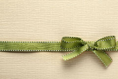 Ribbon bow on golden background Stock Image