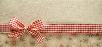 Ribbon bow on golden background Stock Photo