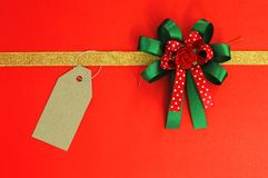 Ribbon and bow on red Stock Images