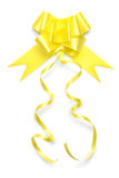 Ribbon bow in shiny golden color on white background Royalty Free Stock Image