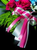 Ribbon bow silver and pink dot pattern at the beautiful flower bouquet. Ribbon bow, silver and pink dot pattern at the beautiful flower bouquet stock images
