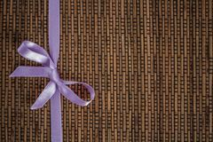Ribbon With Bow on Woven Rattan Royalty Free Stock Image