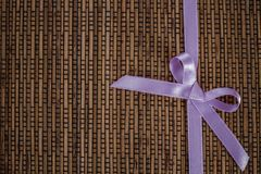 Ribbon With Bow on Woven Rattan Royalty Free Stock Photos