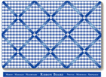 Ribbon Bulletin Board. Tuck favorite photos and keepsakes under blue satin ribbons on blue and white gingham check French style memory board. For headboards Royalty Free Stock Photos