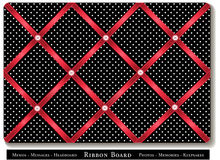 Ribbon Bulletin Board. Tuck favorite photos and keepsakes under red satin ribbons on black and white polka dot French style memory board. For headboards, home Royalty Free Stock Image