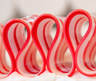 Ribbon Candy Close Up. Detail of ribbon candy in bed of frosting Royalty Free Stock Photography