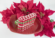 Ribbon Candy on Red Plate Royalty Free Stock Photography