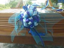 Ribbon on a car. Ribbon decoration blue Royalty Free Stock Photo