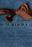 Ribbon on dark jeans Stock Photo