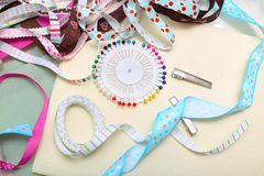 Ribbon with decoration. Scrapbook background. ribbon with decoration Royalty Free Stock Photo