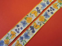 Ribbon with flowers and butterflies Stock Photos