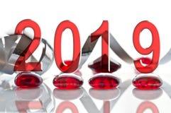 2019 ribbon and glass christmas decorations. 2019, ribbon and glass christmas decorations royalty free stock photography