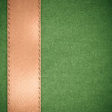 Ribbon on green fabric background copy space Stock Photography